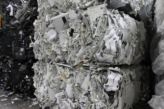 Heavy bales of plastic from electronics are recycled at Balcones Resources in Dallas